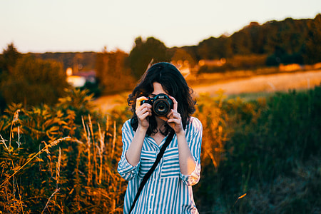 woman's taking pictures