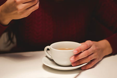 Person Holding White Ceramic Cup