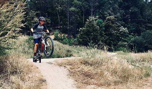 Photo of Boy Riding a Bike
