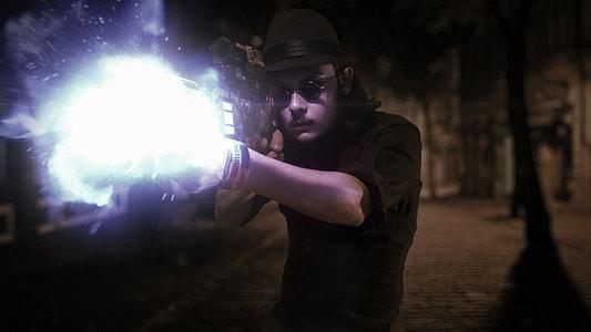 man holding white lighted gun