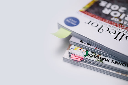 Stack of white magazines with copy space