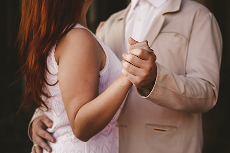 close up photography of couple dancing together