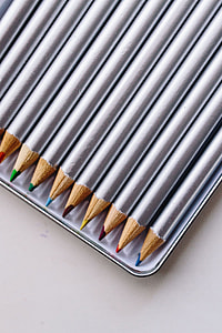 Silver crayons in a box