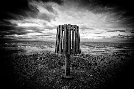Wide-angle monochrome shot taken at the end of a groin on Whitstable Beach, Kent, England