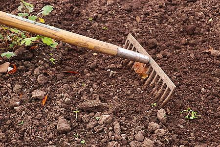 brown rake on soil
