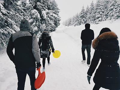 Four People Crossing the Road during Winter Season