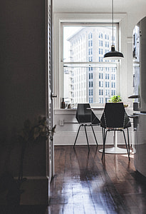 black pendant lamp over table and two chairs near window