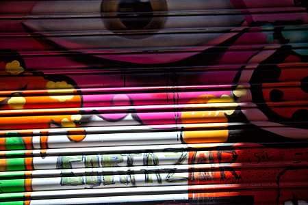 Close-up details of some vibrant street art in the Gothic Quarter of Barcelona, Spain