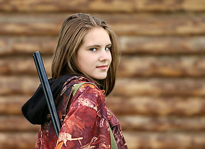 woman holding rifle portrait photo