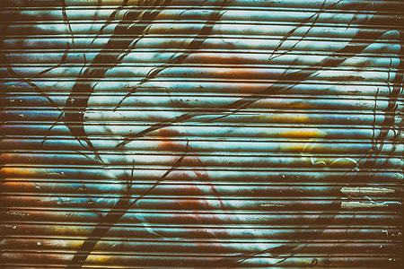 Wide angle shot of multi-coloured metal shop shutter