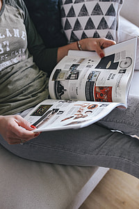 Woman reading a designer magazine on a couch