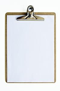 white printing paper in clip board