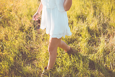 Young Girl Enjoying Her Free Time In a Sunny Meadow