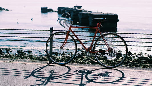 Red Hardtail Mountain Bike Near Body of Water