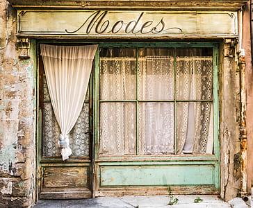 closed green wooden framed door and window
