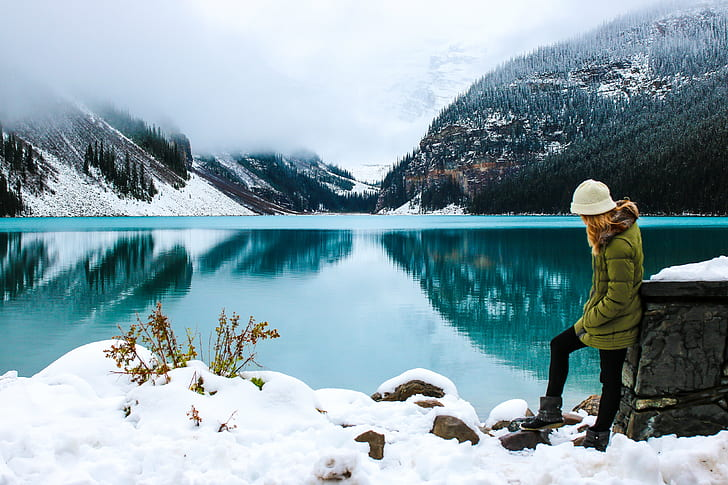 woman standing near bodies of water