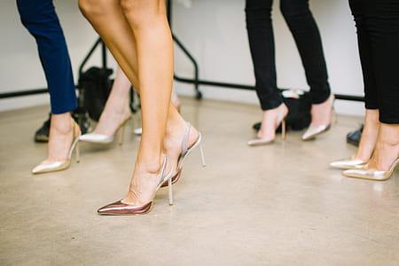 four women wearing stilettos