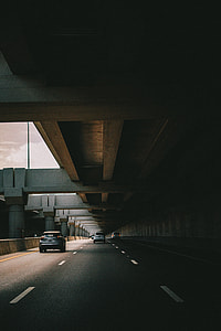 road with cars with concrete structure above