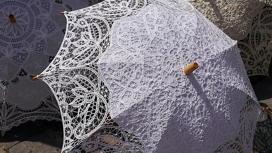 white lace umbrella open