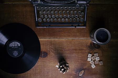 black typewriter on brown wooden top table