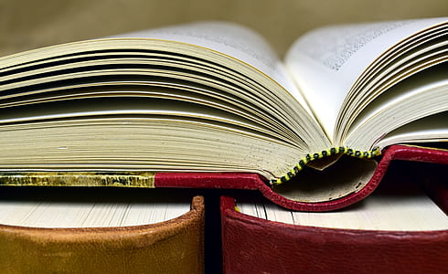 red book on top of two books