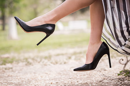 woman wearing pair of black stilettos