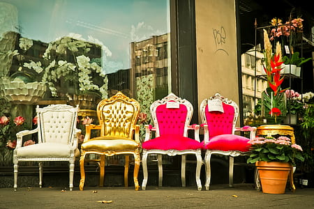four assorted padded chairs