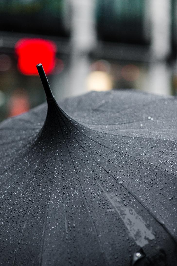 tilt shift photography of a wet black umbrella