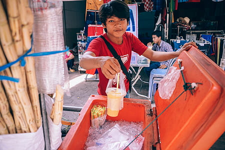 Man Holding Plastic Cup