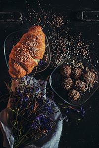 chocolate balls beside roll bread