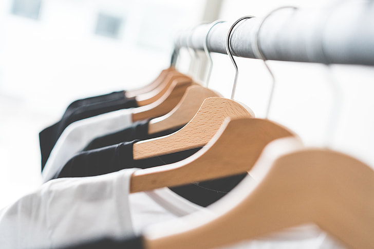 Wooden T-Shirt Hangers in Fashion Apparel Store #2