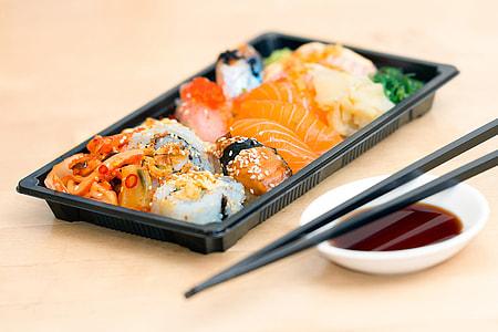 Closeup shot of sushi fish and chopsticks