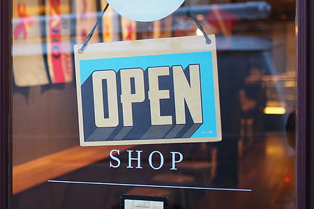 closeup photo of shop with open signage