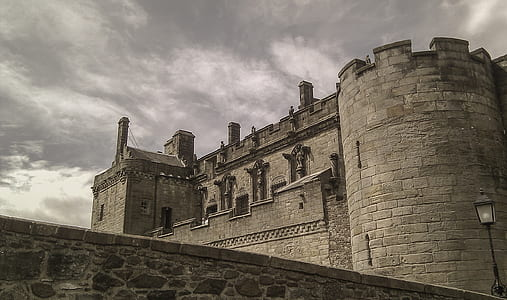 grey concrete castle under cloudy sky during daytime