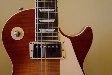 Brown and White Les Paul Guitar