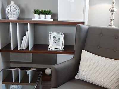 rectangular white wooden photo frame on brown wooden rack