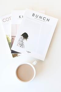 Bunch book beside coffee mug flatlane photograph