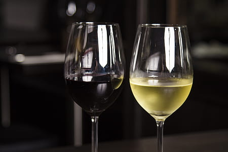 two wine glasses with red and white wine