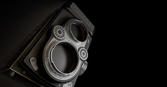 black and gray land camera in grayscale photography