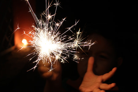 person holding firework during night time