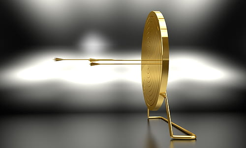 selective focus photography of round gold stand decor