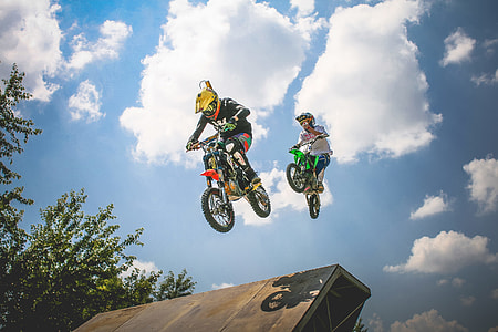 Two Crazy Jumping Pitbikers