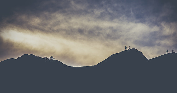 mountain silhouette under clouds