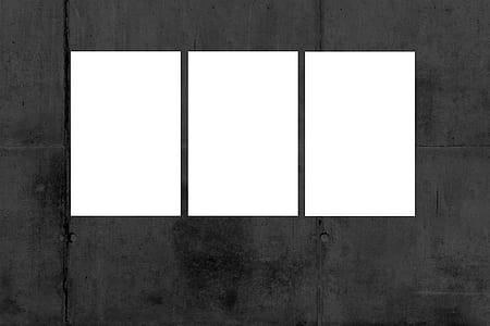 three rectangular white frames