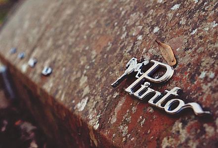close up shot of chrome Pinto emblem