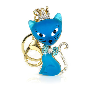 gold-colored and blue cat pendant