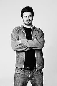 man wearing gray full-zip hoodie