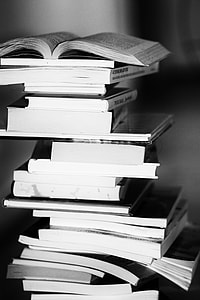 grayscale photography of book stacks