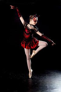 girl wearing black and red dress dancing ballet