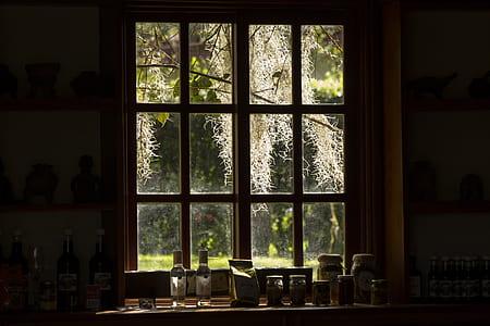 gray wooden framed glass window